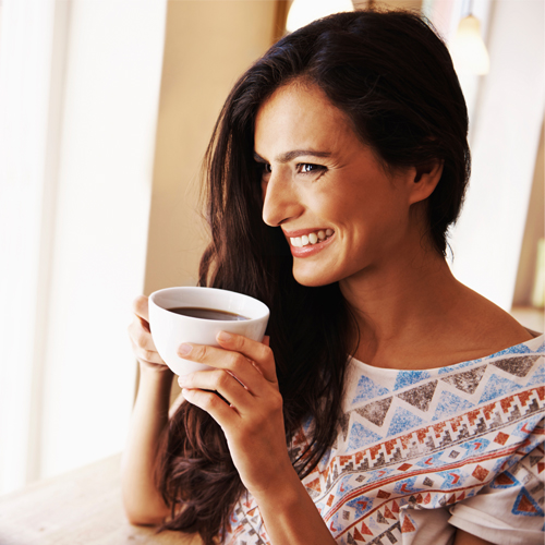 single woman drinking coffee