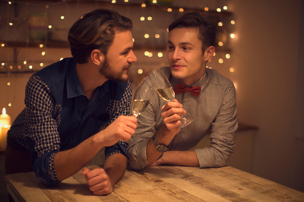 gay couple toasting