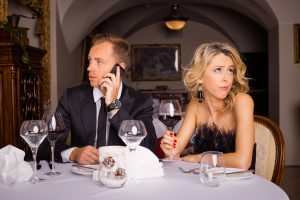 Man talking on the phone while he is on date