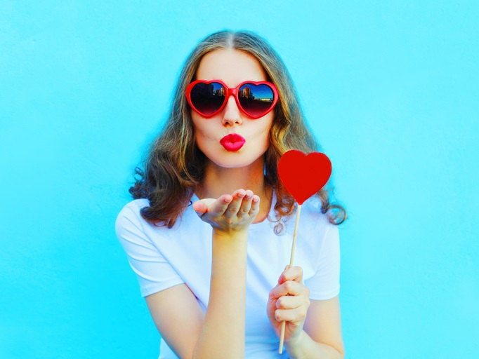 woman with red heart lollipop
