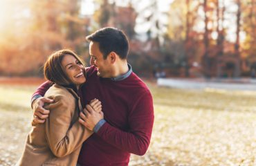 Couple in love hugging with romance and enjoying at public park in autumn