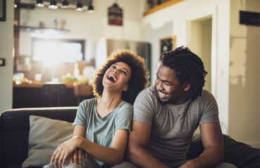 young-cheerful-african-american-couple-in-the-living-room-picture-id1135073129 - cohabiting