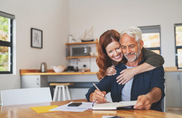 Age gap couple embracing at table